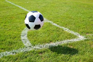 Soccer ball jumping at the corner