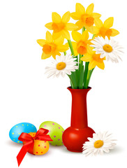 Spring colorful flowers in a vase with Easter eggs