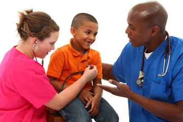 Pediatrician and Nurse With Young Black Child