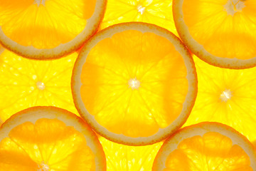 Foto op Plexiglas Plakjes fruit Orange slices background / macro / back lit