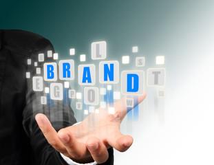 Businessman hand holding with blue brand  alphabet