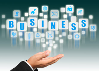 Businessman hand holding with business alphabet