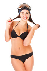 Beautiful girl in underwear in a cap and goggles