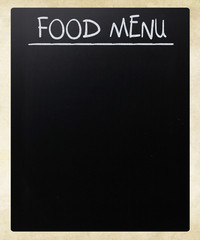 """Food menu"" handwritten with white chalk on a blackboard"