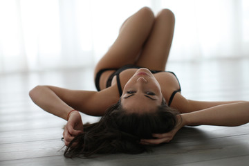 Young woman lying on the floor