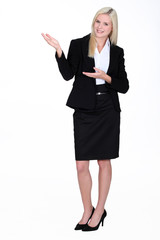 full-body portrait of gorgeous blonde businesswoman