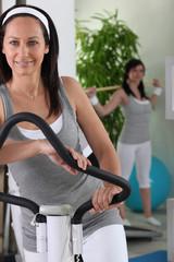 women doing exercise in fitness center