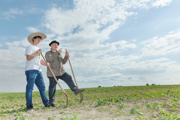 Farmer with an apprentice in the field