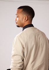 handsome black man looking away from camera