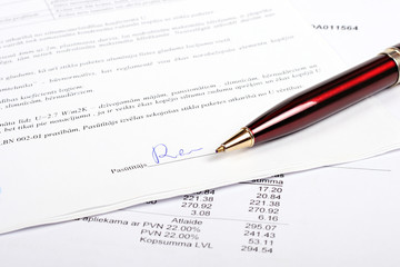 pen and business contract with signature