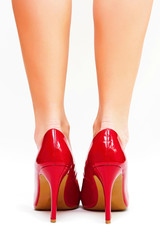 Sexy legs in red high heels isolated on white background