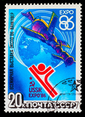 "USSR- CIRCA 1986: A stamp printed in USSR, satellite ""Soyuz"" and"