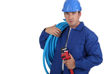 Workers with blue tube roll