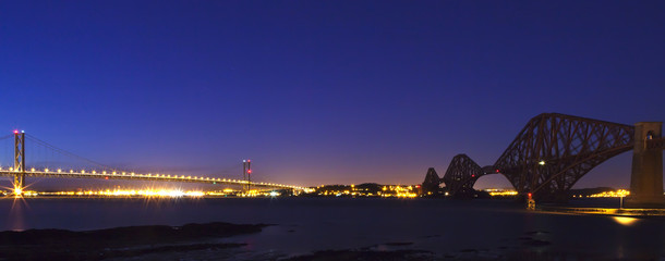 The Forth Road and Rail Bridges at night dusk