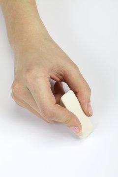 Hand with an eraser