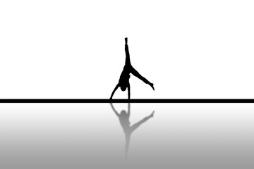 silhouette of gymnast doing cartwheel on floor