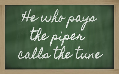 expression -  He who pays the piper calls the tune - written on