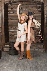 brunette and blonde CowGirls staying in old depot