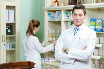 Pharmacy chemist man in drugstore