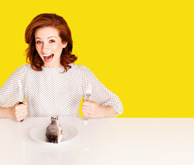 Studio shot of hungry woman on yellow background