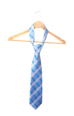Elegant blue tie on wooden hanger isolated on white