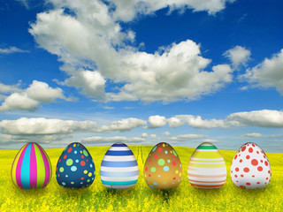 many color easter eggs over blue sky background