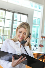 A beautiful office lady on phone and checking profile