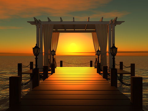 wedding gazebo on the wooden pier into the sea at sunset