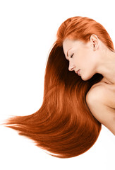 young woman with long healthy shiny red hair