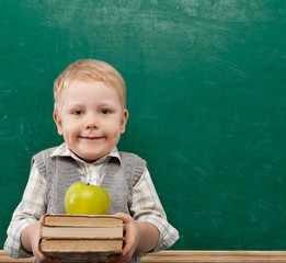 Cheerful smiling child with a book. School concept