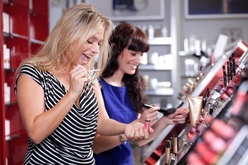 Cheerful women buying cosmetics in a beauty store