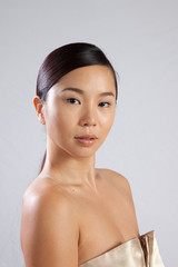 Pretty asian woman looking at the camera
