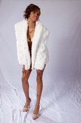 Cute black woman in two piece bathing suit and white fur coat