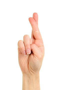 Hand with crossed fingers