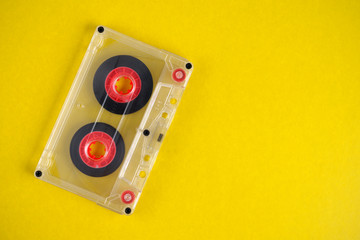 Old audio cassette on yellow background