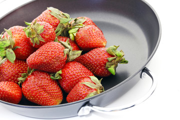 Strawberry in a frying pan.