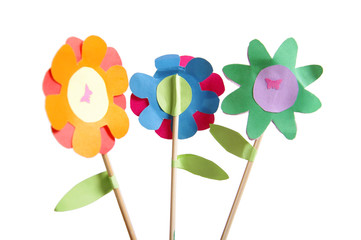 Three colorful paper flowers made by child