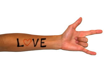 "Love hand sign with ""LOVE"" written on the arm"