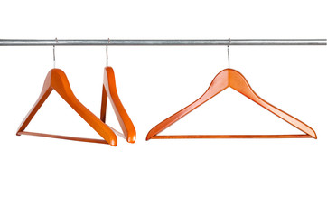 coat hangers on a clothes rail isolated on white