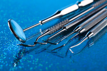Dentist equipment on blue background