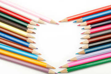 colored pencils crayons composed in the form of heart