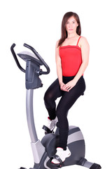 fitness girl with cross trainer posing
