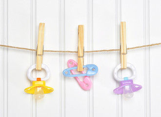 Baby Pacifier Binky Pink on a Clothesline