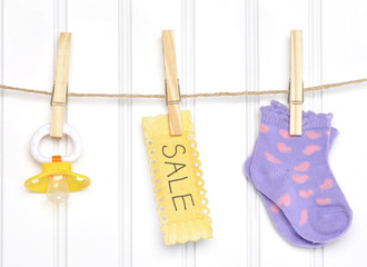 Baby Sale Goods on a Clothesline