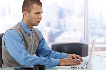 Young businessman concentrating
