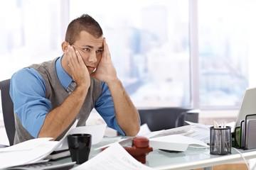 Troubled businessman at desk