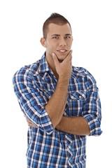 Young man looking at camera, smiling.