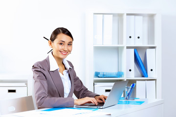 Young woman in business wear working in office
