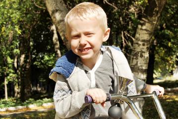 Portrait little boy on the bike