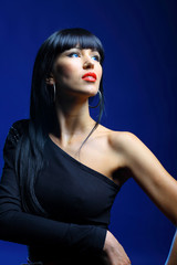 Beautiful woman on a dark blue